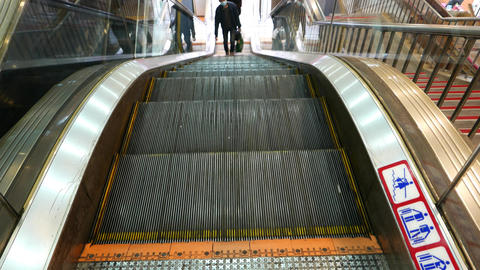 Escalator stairs move upward, slide on camera, top of moving staircase Footage