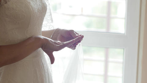 Bride in front of a glass window 12a Footage