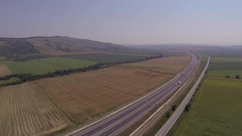 Aerial view of traffic on a highway car and located along a national road Footage