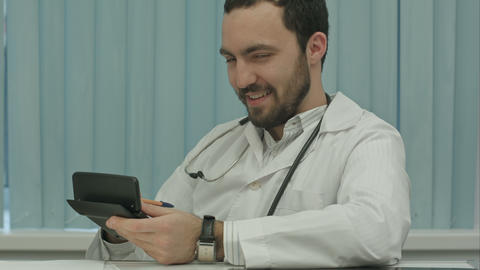 Sinister bearded doctor with a calculator. calculation of price Footage