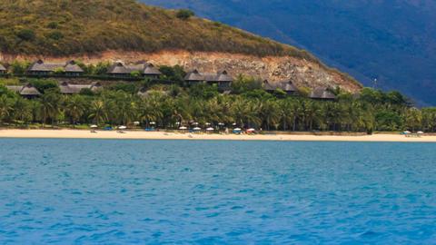 village resort on hill sand beach with umbrellas on island Footage