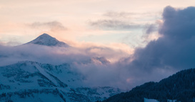 Time lapse of epic sunset in Austrian Alps with clouds forming Footage