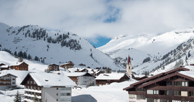 Time lapse of clouds moving over an idyllic mountain village in Austria Footage