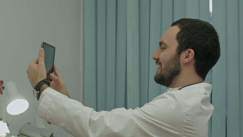 Male doctor taking selfie, smiling Footage