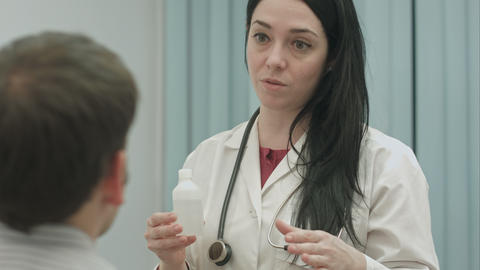 Female Doctor Recommending And Talks About Effect Of Drugs To Patient stock footage
