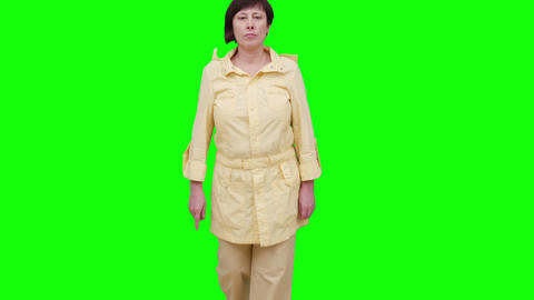 Woman Approaches The Camera. Green Screen stock footage