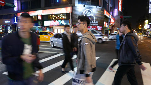 Taiwanese boy walk on pedestrian crossing, night street, tracking portrait shot Live Action