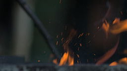 Slow motion of fire sparks in a grill Footage