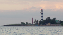 Black and white striped lighthouse at a river mouth Footage