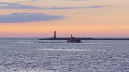 Pilot ship returning to port during vivid summer sunset Footage