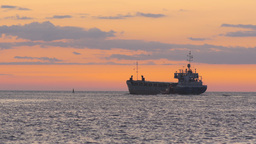 Maritime Pilot Convoys A Bulk Carrier Leaving Port Into Sea stock footage