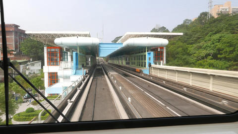 View from rear cabin window of departing metro train, overground station Footage
