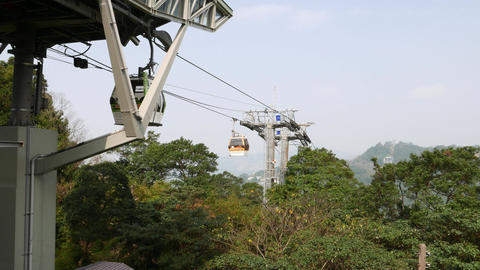 Modern gondola lift, cableway transportation system, cabin travels up and down Footage