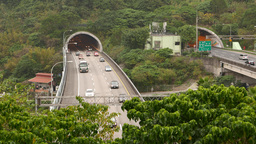 Front view mountain tunnel highway exit, car traffic Footage