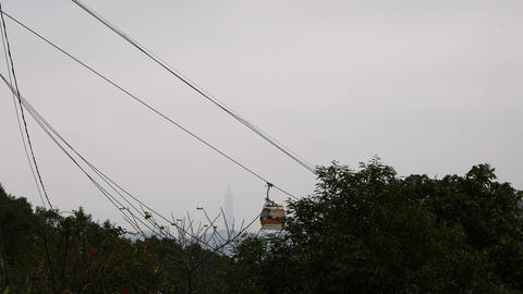 Cableway gondola against foggy skyline and Taipei 101 miracle Footage