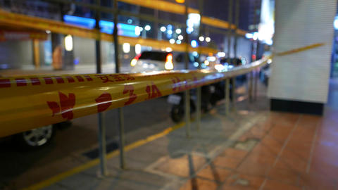 Closeup yellow tape with red text, dangerous area enclosed Footage