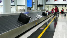 Baggage carousel, man quickly take small backpack from conveyor tape Footage