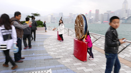 Little girl pose at avenue of the stars, with film reel sculpture Footage