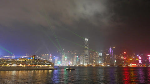 Wide view of night panorama of illuminated city and laser show Footage