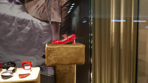 Luxury red women shoes in boutique showcase, panning around Footage