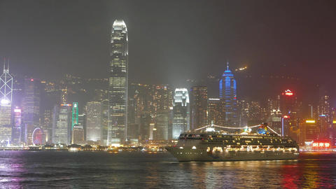 Hong Kong Island panorama at night, cross harbour view, cruise ship move back Footage