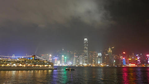 Night city waterfront panorama, illuminated buildings, laser show Footage