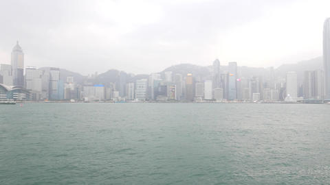 Victoria harbour and HK Island panorama cloudy view, pan shot Footage