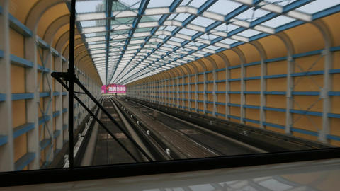 Futuristic tunnel, view from rear window of moving metro train Footage