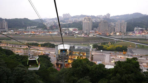 Cablecar cabin approach terminal station, cityscape background, aerial view Footage