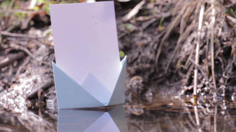 Blue paper boat floating on water 101 Footage