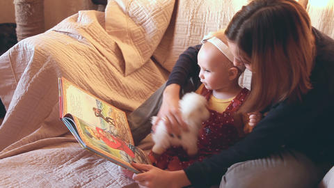 Mother and daughter are reading fairy tales Footage