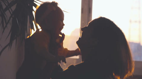 Mother With Her Child Are Playing On Sunset stock footage