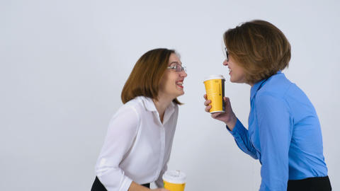 Businesswomen On Coffee Break Telling Funny Stories stock footage