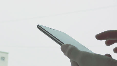 Womans hand using a smartphone Footage