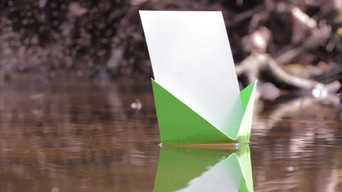 Green paper boat floating on water among thousands of midges 92c Footage