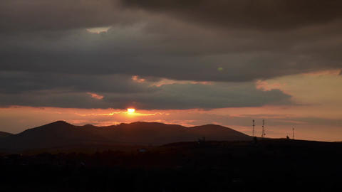 Sunset 60. Orange sunset over high hills Footage