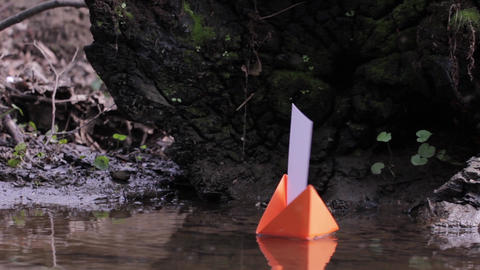 Red paper boat that ran aground on the sandy shore 88 Footage