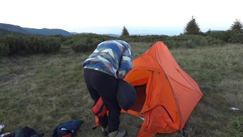 Tourist stow sleeping bagto a pouch in front of the tent 16a Footage