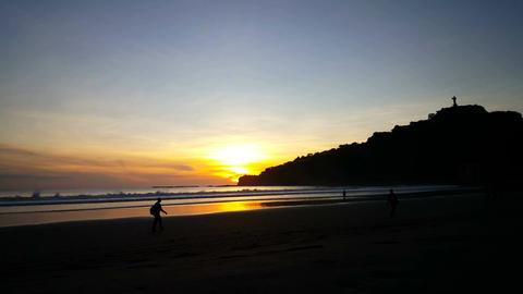 Men walking at sunset on the beach of San Juan del Sur Footage