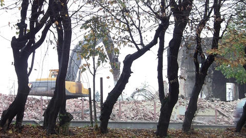 Machinery working on the demolition of buildings near a frequented road 4 Footage