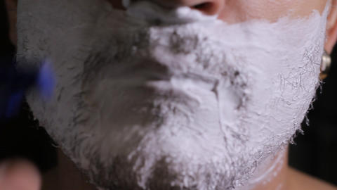 man shaves disposable razor close up Stock Video Footage