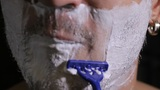 man shaves disposable razor close up Footage