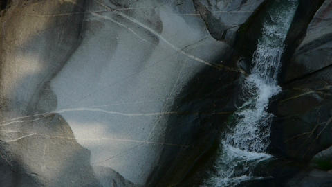 Mountain waterfall stream into pool from multilayer... Stock Video Footage
