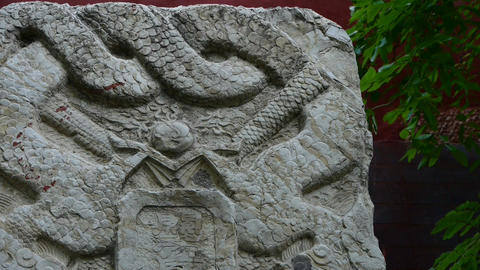 Stone monument with dragon pattern at temple entrance,historical monuments,shaki Footage
