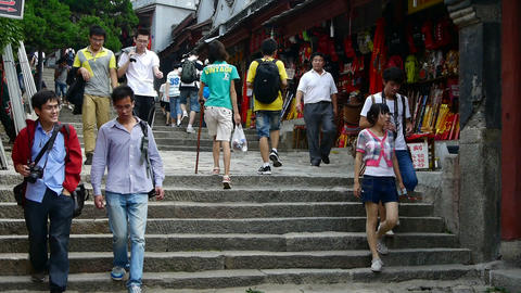 China tourists walking in mountain stone steps Stock Video Footage