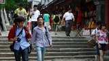 China tourists walking in mountain stone steps Footage