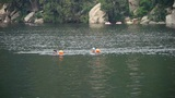 People swimming in lake with floats buoy,relying on Castle Peak Footage