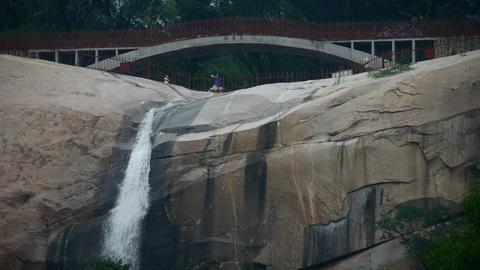 Mountain waterfall stream,bridge,forests & shrubs Stock Video Footage