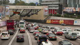 Seven lanes squeezed into two at the tunnel entrance, traffic jam Footage