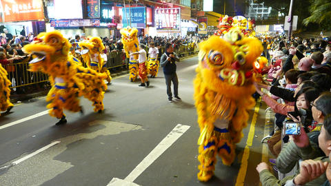 Dragon costumes at parade procession on night street, with sound Footage